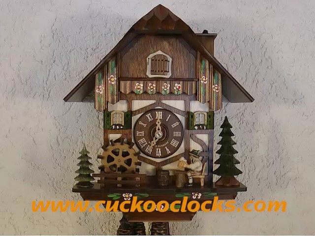 Cuckoo Clock<br>Black Forest house with moving beer drinker and mill wheel, Chimney Sweep