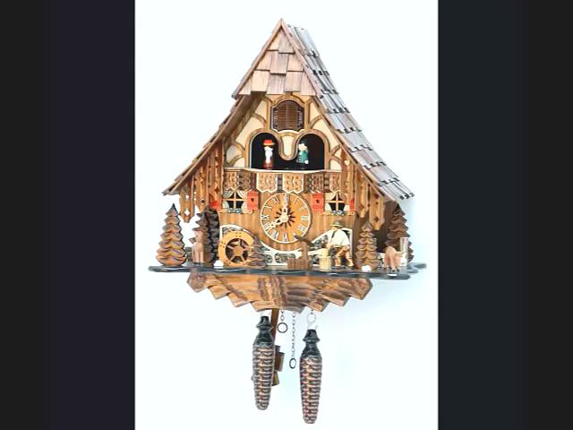 Кварцевые часы с кукушкой<br>Шварцвальдский дом с подвижным дровосеком и мельничным колесом, музыкальные