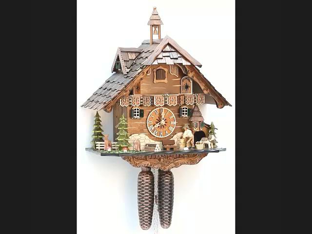 Kuckucksuhr<br>Schwarzwaldhaus mit beweglichem Holzhacker