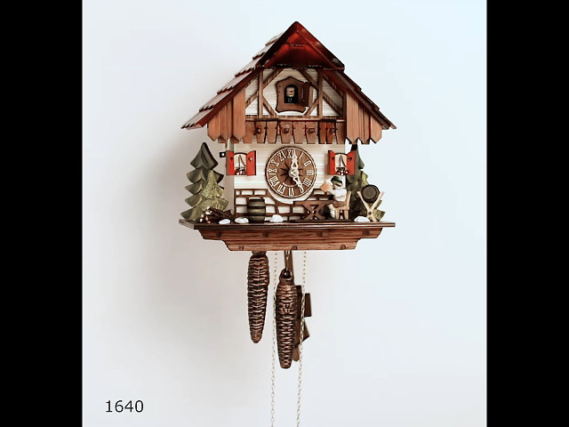 Cuckoo Clock<br>Black Forest house with moving beer drinker