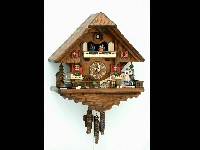 Pendule à coucou<br> avec un couple et une roue de moulin