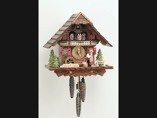 Cuckoo Clock<br>Black forest house with music and dancers KA 3704  EX