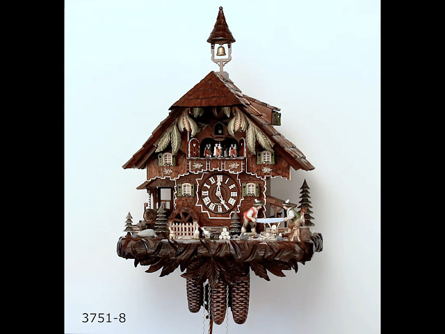 Cuckoo Clock<br>Black Forest house with moving wood sawers and mill wheel