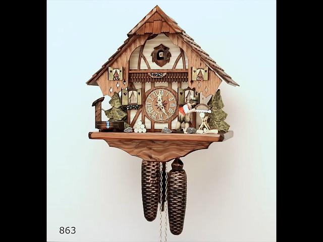 Reloj cucú<br>Casa de la selva negra con leñador que se mueve