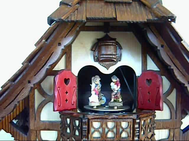 Cuckoo Clock<br>Black Forest house with children on a see-saw and moving water wheel